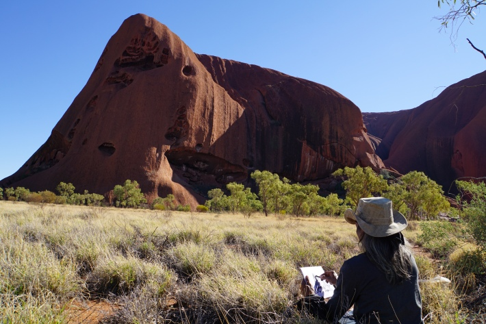 Budhiana painting on location at Kata Juta. Image Made Budhiana