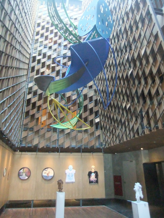 Artotel exhibition space oncluding sculpture in atrium by Pintor Sirat