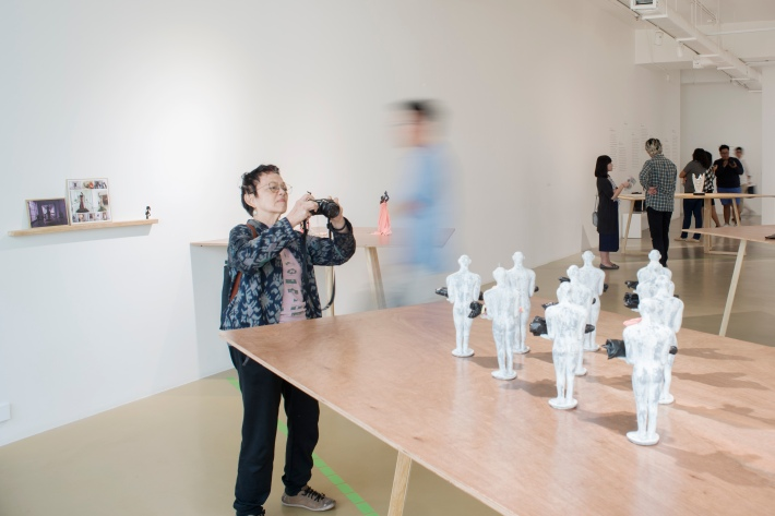 An audience member photographs part of the Unsung Museum- Photo by Wirya Satya Adenatya