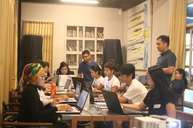 volunteers, futuwonder members and wiki pedia indonesia at work on laptops during the edit-athon