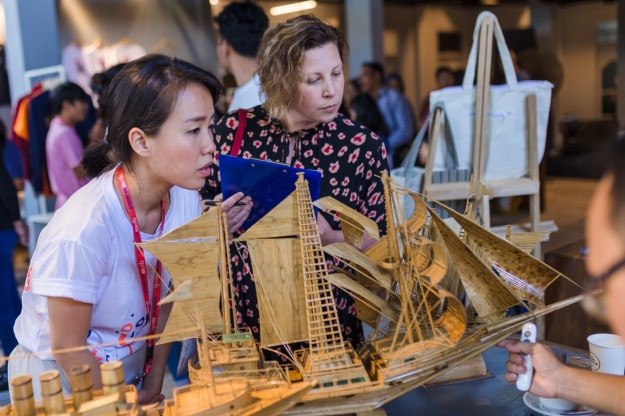 """Ella Ritchie (Director & Co-Founder, Intoart UK), accompanied by Samantha Tio (Director & Co-Founder, Ketemu Project), while judging at """"Pasar Ketemu"""" Image courtesy of KETEMU PROJECT"""