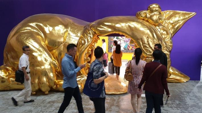 Art Jakarta fair attendees and installation by Filippino artist Ronald Ventura at Yavuz Gallery. Image by Richard Horstman