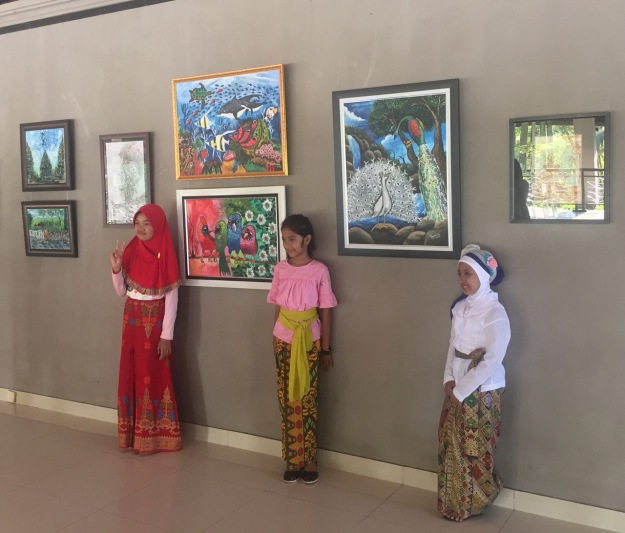 "Artists pose with their works during the opening of during the opening of ""Art Exhibition by Children Sanggar Bares - There is no Truth only HONESTY"" 12 – 31 October at the Nyana Tilem Museum, in Mas. Image courtesy Soemantri Widagdo"